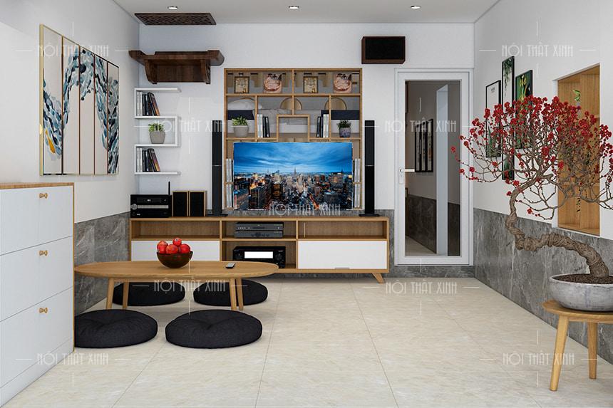 Không gian nội thất phòng khách rộng rãi nhờ việc sử dụng kệ trang trí thông minh có nhiều ngăn đựng đồ tạo cảm giác gọn gàng, bộ bàn trà kiểu Nhật ngồi bệt uống trà thay thế ghế sofa.